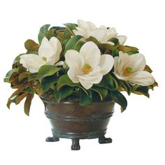 The magnolia centerpiece that gives and just keeps on giving. This abounding magnolia arrangement features signature flower and foliage, crafted using a combination of innovative technology and materi