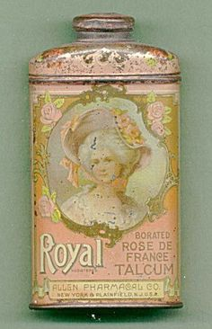 What a cute accent for a bathroom or bedroom.. pink vintage talcum powder tin