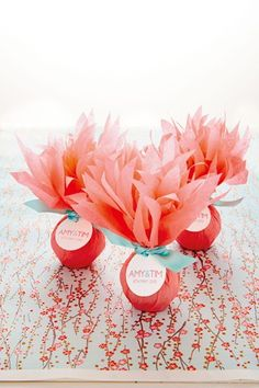 Flowering Favours - For your favours wrap a flower bulb in some pretty tissue paper, tie with ribbon and finish off with a pretty name tag