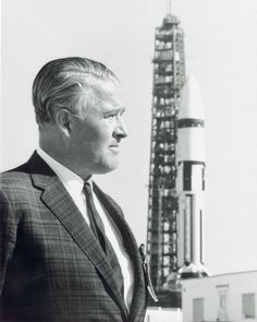Dr. Wernher von Braun stands in front of a Saturn IB launch vehicle at Kennedy Space Flight Center. Dr. von Braun led a team of German rocket scientists, called the Rocket Team, to the United States, first to Fort Bliss/White Sands, later being transferred to the Army Ballistic Missile Agency at Redstone Arsenal in Huntsville, Alabama.