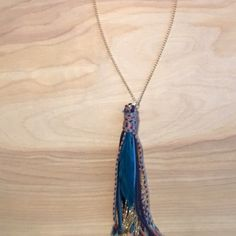 Tassel necklace Tassel necklace with feather, leather straps and gold links! Jewelry Necklaces