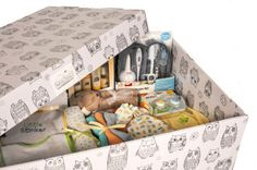 How awesome is this Finnish baby box? We carry a selection of Finnish baby boxes. A great baby shower gift and unique baby gift. They come with a baby box, mattress pad and fitted sheet (for baby to sleep in) and newborn essentials, like onesies, lovies, muslin swaddles and more!