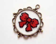 cross stitch pendand red bow by craftinghard on Etsy Tiny Cross Stitch, Beaded Cross Stitch, Cross Stitch Boards, Modern Cross Stitch, Beaded Embroidery, Cross Stitch Embroidery, Embroidery Patterns, Hand Embroidery, Cross Stitch Patterns