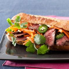 Vietnamese-Style Steak Sandwiches  1/2 cup shredded carrots   2 teaspoons rice vinegar   2 small baguettes, split   1/3 cup mayo   1 small sliced jalapeno chile   1/4 cup cilantro   1/2 pound leftover sliced skirt or hanger steak    Directions   Toss carrots with vinegar. Toast baguettes; slather with mayo and layer with remaining ingredients.