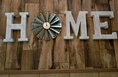 """Our Wooden Home Sign comes with a full metal windmill in the shape of an """"O"""" to add fun and eclectic farmhouse style to your space. Sign Letters, Barn Wood Crafts, Best Housewarming Gifts, Single Wide, Bedroom Signs, Home Signs, Windmill, Wood And Metal, Vintage Signs"""