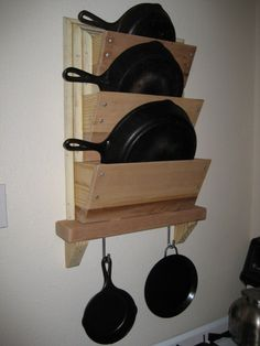 rack for cast iron skillet storage Skillet Rack - I finally got tired of having to shuffle our collection of cast-iron skillets from the oven to the stovetop every time we wanted to bake something. The kitchen in our apartment doesn't really… Kitchen Organization, Kitchen Storage, Organizing, Kitchen Pantries, Woodworking Toys, Woodworking Projects, Diy Kitchen, Kitchen Decor, Kitchen Tips