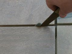 Installing Slate Floor Tiles: Removing The Spacers and Excess Mortar