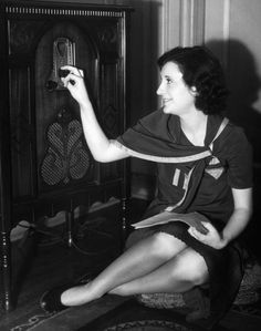 Woman Listening To A Radio, C. 1930s