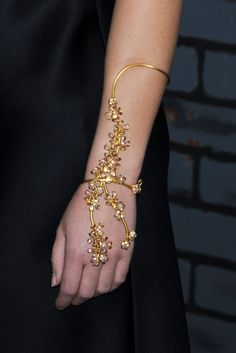 Emma Watson showed off her floral gold bracelet while attending the 'Harry Potter and the Deathly Hallows' premiere.