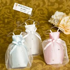 The perfect favor for bridal shower and bridal  luncheons  Our bridesmaid sachets are filled with a fragrant lavender  scent. Each handmade satin sachet stands on their own and comes with a  convenient place card clip.  Add your seat assignment cards, or a favor  tag with your names or a thank you message our happy bride and happy  bridesmaid tags look great.  Each sachet stands about 5 inches tall.   Available in the following colors:  pink, ice blue, or white.  Sold as a  set of four.  Add