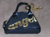 Price $10.00 Small bag that looks like a purse that is a change purse and keychain. Angel is in gold tone metallic print on front of bag. Two small do...