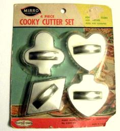 Vintage Cookie Cutters in Original Packaging!  My mom had some just like these- they were popular for making cookies and sandwiches for bridge clubs.