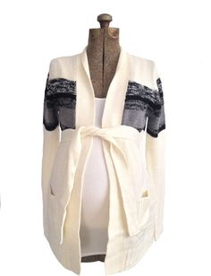 Ivory Sweater Cardigan just $24.99. Perfect for a cozy winter maternity outfit. www.heritwinematernity.com.