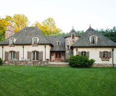 Stony Success - Stone is cleverly used as an accent to add distinction to this home?s interesting architectural features. A large chimney, turret, front patio, and foundation all pop thanks to a medley of warm stonework. Romantic arched windows, French do French Cottage, French Country House, French Country Decorating, Style At Home, French Style Homes, French Country Exterior, Country Home Exteriors, Interior Exterior, Exterior Design