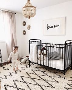 Nursery goals: black + white, iron baby crib.