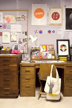 """awesome craft space (kate alexander/matt kardos on #designsponge) """"My studio. I had as much fun creating this space as I do spending time in it. I just couldn't pass up the desk, chair and plan drawers when I saw them at my local vintage shop. The wooden containers are from there, too. We made the notice frame. You can see my """"mood boards,"""" which I created for each room before we moved in. I finally put all my home magazines to good use! Harry's room is the closest to how I imagined it."""""""