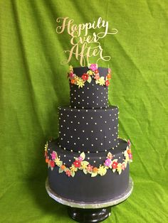 these colors are so fun for a warm weather wedding and they really stand out on this black wedding cake... why not try something different for your event?