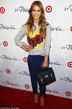 Jessica Alba, 32, kicked off her New York Fashion Week on Thursday in a cartoon-strip sweater as she arrived at Phillip Lim's show for Target