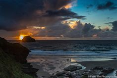 Evening Surfers at Trebarwith Strand, England