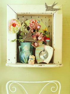 Once a built-in phone niche, this shadow box frames a beautiful display: http://www.bhg.com/decorating/decorating-style/flea-market/decorate-with-vintage-finds/?socsrc=bhgpin030714art&page=9