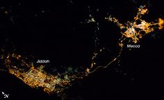 Mecca and Jidah at night with pilgrim road. Photograph taken from the International Space Station.