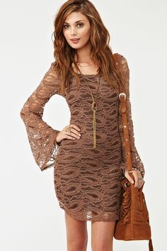 omg..looooove this dress..love the belled sleeves  (nastygal.com)..ADORABLE clothes