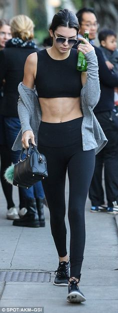 Kendall Jenner in a midriff-baring top and leggings while Kylie covers up | Daily Mail Online