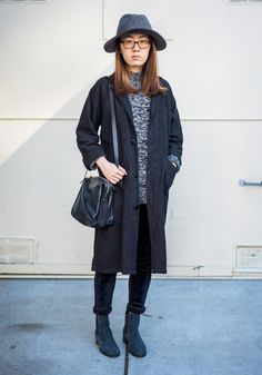 """Shisi, 25""""Black is the main color in my wardrobe. I like Japanese and Belgian designers like Yohji Yamamoto and Ann Demeulemeester. Now I'm wearing a hat and a coat from Urban Outfitters, a sweater from Barney's, Tod's shoes and a Cos bag.""""Jan 24, 2015 ∙ The Mission"""