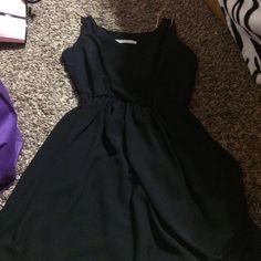 Little Black dress Super cute black flowey dress. Size small. Gold straps. Dresses