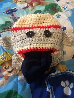 Cute little Sock Monkey Pajama Eater!! This guy loves to go nom nom nom on your little one's jammies!