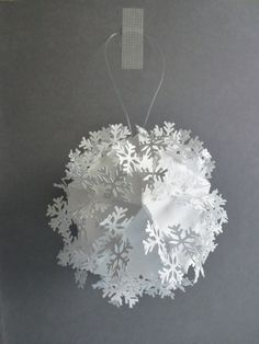 Tyvek paper bauble/Christmas decoration with cut out linking snowflakes. £22.00, via Etsy.