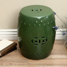 Turn your garden into a place where you want to relax and unwind with this decorative garden stool. The crackled design on the porcelain stool makes it look like an antique, and the dark green color will complement your favorite plants and flowers.