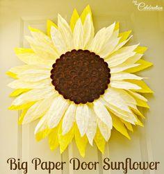 Big Paper Twist Door Sunflower! A fun change from a wreath at Little Miss Celebration @Cindy Eikenberg (littlemisscelebration)