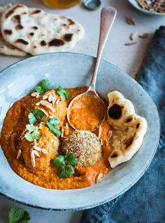 Vegetables, cashew nuts, dried fruit and spices are rolled into balls, baked and served in a rich tomato curry. Don't be put off by the large list of ingredients, many are repeated.