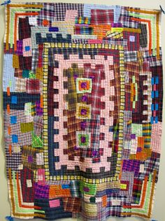 Plaids Gone Mad by Margaret Fabrizio, 2014.  San Jose Museum of Quilts and Textiles. Photo by The Plaid Portico.