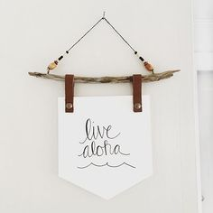 "Hand lettered inspirational quote ""Live Aloha."" Hanging Driftwood quote wall banner"