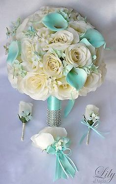 Wedding Planning Model: This wedding flower package is made with ivory open Roses, Robins Egg blue Calla Lilies accented with Robins Egg blue Rock Cress. Silk Flower Bouquets, Flower Bouquet Wedding, Bridesmaid Bouquet, Silk Flowers, Bridal Bouquets, Tiffany Blue Bridesmaid Dresses, Bridesmaids, Tiffany Blue Dress, Flowers Wine