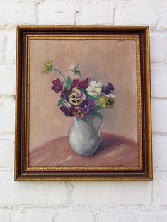 A very refined and delicate painting, a bunch of Pansies in a white pitcher. The colors are soft and the paint is almost velvety. There is no signature or dates but I would date it as very early 1900s. In gilt frame. Measures with frame: ca 13.4 x 11.7 inches (34,5 x 30 cm). In good antique condition. The canvas shows signs of time. Handwritten pencil notes on the back. Please dont hesitate to contact me if you would like more info or pictures.