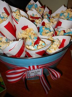 My Dr. Seuss baby shower. Hop on Pop popcorn with melted blue chocolate and red Swedish fish.