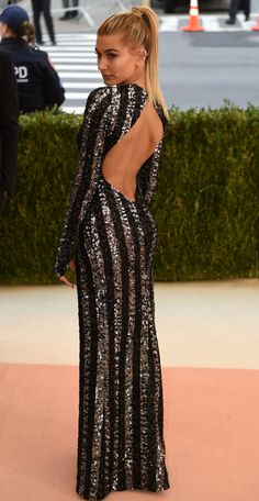 Hailey Baldwin: http://www.stylemepretty.com/2016/05/03/the-most-outrageous-looks-from-the-met-gala-you-need-to-see-to-believe/