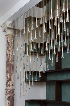 The Pour by Design Haus Liberty May 21st, 2014 Dara Huang and Lisa Hinderdael of Design Haus Liberty have recently completed 'The Pour', a raindrop chandelier installation in New York City.
