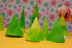 Painted Pine Forest Playscape -- out of coffee filters.  Also like her brilliant idea of having the kids paint on a cookie sheet covered with foil.