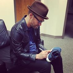 """Toby Mac at a St. Louis radio station autographing his shoes and giving them to """"Scott"""""""