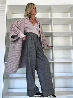 Grey wide leg pants and a chunky knit sweater.
