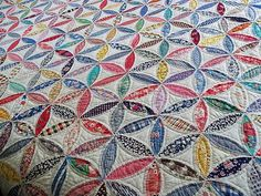 flower of life quilt. i want to try something similar with the cathedral window technique