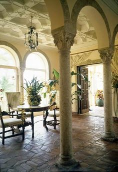 European style in Florida; brick floor and trompe l'oeil curtains
