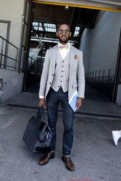 Shop this look on Lookastic:  http://lookastic.com/men/looks/sunglasses-dress-shirt-bow-tie-pocket-square-waistcoat-blazer-jeans-tote-bag-derby-shoes/5790  — Black Sunglasses  — White Dress Shirt  — Tan Plaid Bow-tie  — Brown Pocket Square  — Grey Gingham Waistcoat  — Grey Blazer  — Navy Jeans  — Charcoal Gingham Canvas Tote Bag  — Brown Leather Derby Shoes