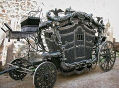 Amazing horse-drawn hearse.