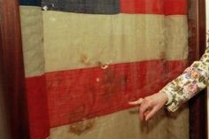"""This flag was draped outside Lincoln's theater box the night he was shot by John Wilkes at Ford's Theatre. """"Someone inside the box grabbed the flag from outside and used it to cradle Lincoln's head until they could carry him from Ford's Theatre to Peterson house.""""  Jeannie Gourlay, actress in """"Our American Cousin"""", which was playing that night, and daughter of Thomas Gourlay, kept the flag in her possession until she died in 1924."""