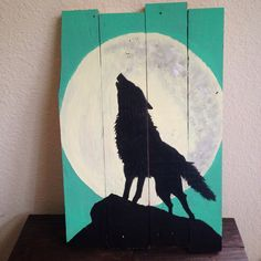 Wolf howling at the moon silhouette hand-painted pallet art. (BostonRustics.org)